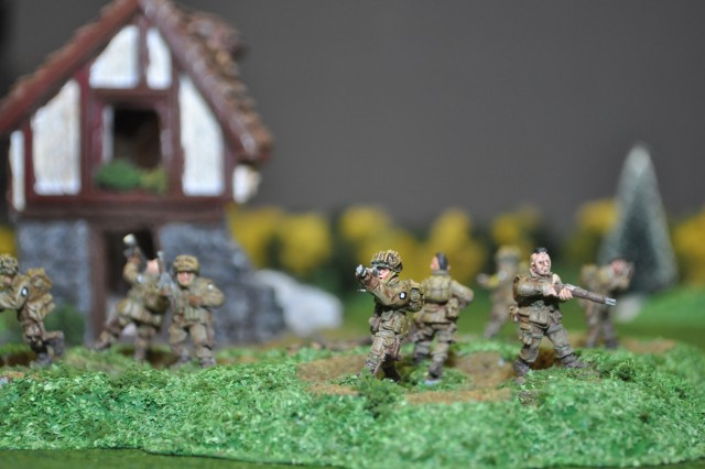 Mikhael Weitzel, Army Contracting Command historian, spent more than 100 hours painting 28mm miniature figurines and landscape to depict the aerial assault of the 3rd Battalion, 506th Parachute Infantry Regiment, and a platoon from the 326th Engineer Battalion during D-Day.