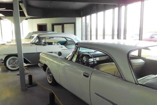 Col. John P. Hannon, Army Contracting Command-Rock Island military deputy director, has four of his cars on display at the Kansas City Auto Museum, Olathe, Kansas, including his 1958 Chrysler 300D Coupe (foreground) and his 1955 Oldsmobile Super 88 (two-tone in background). Hannon said he has approximately a dozen cars that he stores around the Midwest.