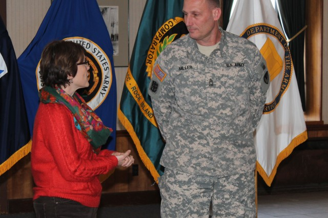 Melanie Johnson, ACC-RI executive director, congratulates Master Sgt. Peter Miller following his promotion to master sergeant.
