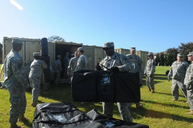 Members of the 8th Theater Sustainment Command's newly-formed Humanitarian Assistance Survey Team transport and set up their expeditionary command post as part of a validation exercise at Schofield Barracks, Hawaii, June 2-6. The exercise prepared the team for its first three-month rotation as U.S. Army Pacific's primary on-call HAST element by assessing its ability to self-sufficiently deploy, survey, and facilitate requested humanitarian assistance throughout the region within 12-24 hours of notification. (U.S. Army photo by Sgt. 1st Class Mary E. Ferguson, 8th Theater Sustainment Command Public Affairs/Released)