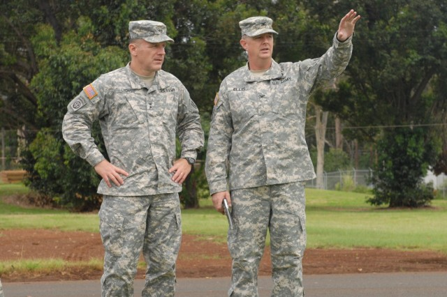 Maj. Gen. Stephen Lyons, commander of the 8th Theater Sustainment Command, visits the newly-formed Humanitarian Assistance Survey Team in action at its expeditionary command post as part of a validation exercise at Schofield Barracks, Hawaii, June 2-6. The exercise prepared the team for its first three-month rotation as U.S. Army Pacific's primary on-call HAST element by assessing its ability to self-sufficiently deploy, survey, and facilitate requested humanitarian assistance throughout the region within 12-24 hours of notification. (U.S. Army photo by Staff Sgt. John Garver, 8th Theater Sustainment Command Public Affairs/Released)