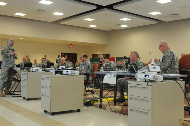 Members of Task Force 76 conduct a digital command post exercise at the Air Reserve Complex June 10-13 in preparation to take over Command and Control of the U.S. Army chemical, biological, radiological, nuclear response elements in October. In the event of a catastrophic incident, it will be TF76's mission to augment local and state officials in response efforts. (U.S. Army Photo by Sgt. Ange M. Desinor, 13th Public Affairs Detachment)