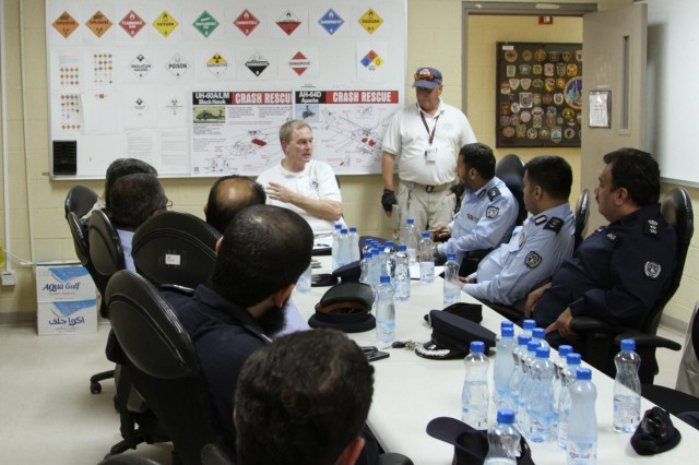 Mark Lawler, Fire Chief Area Support Group-Kuwait discusses ways to cooperate and partner on issues dealing with fire safety, fire protection and fire education with fire chiefs, managers and directors from local Kuwait districts. The demonstrations took place during a partnership tour between U.S. firefighters and their local Kuwait counterparts on Camp Arifjan June 10, 2014. (Photo by Army Staff Sgt. Julius Clayton, U.S. Army Central)
