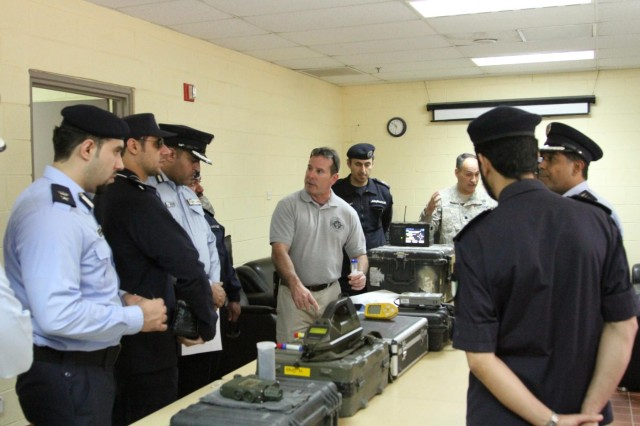 Richard Shaw, fire captain at Kuwait Naval Base demonstrates some of the equipment used by the firefighters here on Camp Arifijan to fire chiefs, managers and directors from local Kuwait districts. The demonstrations took place during a partnership tour between U.S. firefighters and their local Kuwait counterparts on Camp Arifjan June 10, 2014. (Photo by Army Staff Sgt. Julius Clayton, U.S. Army Central)