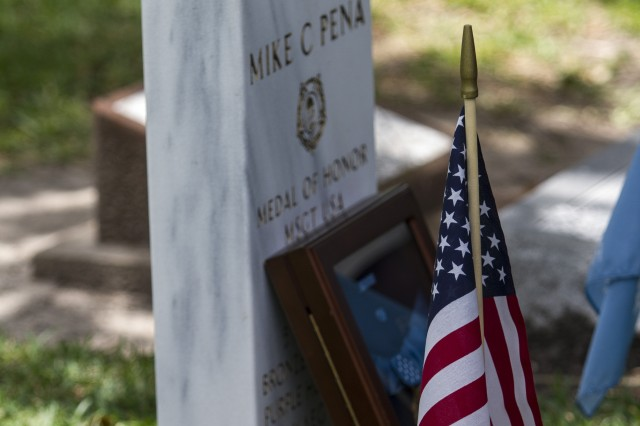 The Medal of Honor for Master Sgt. Mike C. Peña, 5th Cavalry Regiment, 1st Cavalry Division, was temporarily on display during a ceremony at Peña's resting place June 8, 2014, at Cedarvale Cemetery in Bay City, Texas.  A Medal of Honor Memorial Headstone in Peña's honor was unveiled during the ceremony. Peña was one of 24 Soldiers from World War II and the Korean and Vietnam Wars to have their Distinguished Service Cross upgraded to the Medal of Honor in a March 18, 2014, ceremony at the White House.