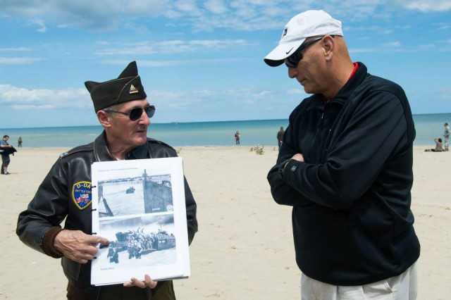U.S. Army Chief of Staff Gen. Ray Odierno (right) takes a tour of Utah Beach, the right flank of the Allied landing beaches during the D-Day invasion of Normandy, with the help of D-Day Historian and tour guide Mr. Ellwood Von Seibold in Normandy, France 5 Jun. 2014.