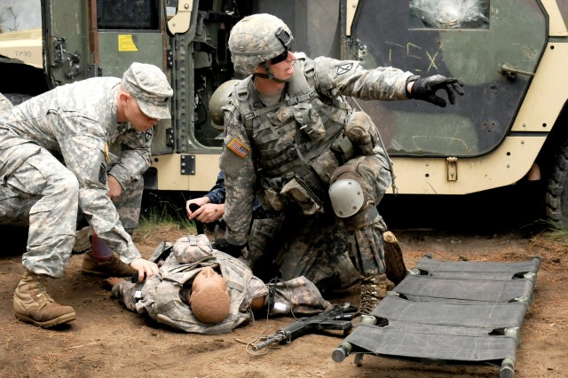 "Pvt. Eric Mitchell, 2nd Battalion, 22nd Infantry Regiment, calls out commands after locating a ""casualty,"" June 6, 2014, at Fort Drum, N.Y."