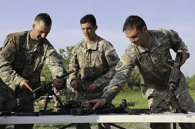 Soldiers assigned to 1st Squadron, 89th Cavalry Regiment, 2nd Brigade Combat Team, 10th Mountain Division (LI), assemble eight different weapons systems during a spur ride held June 2-3 on Fort Drum. Each weapon system was disassembled and the parts mixed together in a box. Soldiers had only 11 minutes to identify the parts and reassemble them.