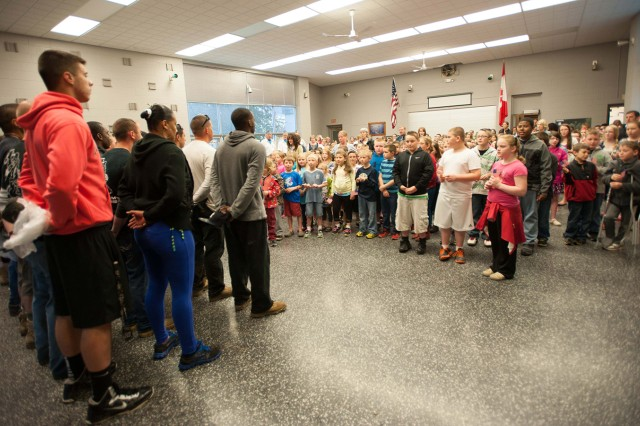 More than 200 children from Clayton Elementary School surprised Soldiers of A Company, 1st Brigade Special Troops Battalion, 1st Brigade Combat Team, with songs of thanks May 16 after the Soldiers repaired the local children's park and restored it to proper playing condition.
