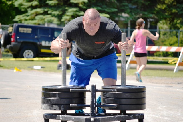 Staff Sgt. Jeffrey Toniatti, a cadre member with the Warrior Transition Unit, performs the sled push during Saturday's event. Toniatti won first place in the men's light weight division, after placing third in last year's event.