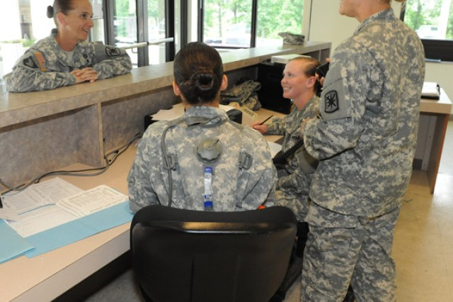 Command Sgt. Major. Teresa Duncan, left, 787th Military Police Battalion, listens as Staff Sgt. Jennifer Dively, right, Company D, 787th Military Police Battalion drill sergeant, explains patrol desk training at Stem Village. Sitting are Pfc. Kenberlyn Villaeser and Pvt. Kennedy Thompson, Company D, 787th Military Police Battalion.