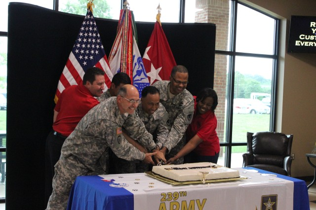 Cutting the 239th Army birthday cake, from left, are retired Col. John Wright of AUSA's Redstone-Huntsville Chapter; Col. Ricky Pressnell of AMC, representing the oldest Soldier; Spc. Eric Flores of the AMC Band, representing the youngest Soldier; Gen. Dennis Via, AMC commander; Command Sgt. Maj. James Sims of AMC; and De'Lisa Henderson, recreation delivery coordinator for Family and Morale Welfare and Recreation, representing civilian staff.