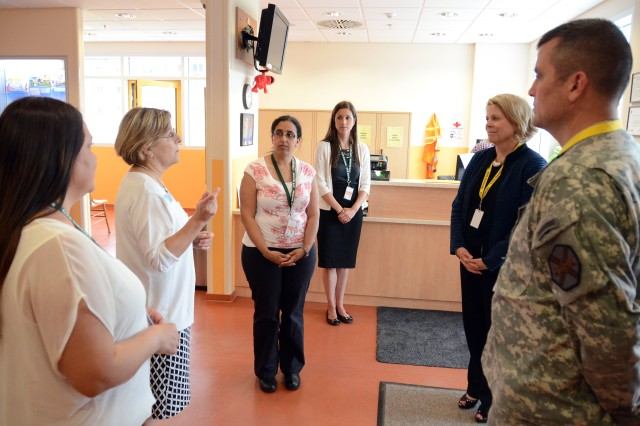 Tamara Browning, second from left, chief of Child, Youth and School Services, briefs Kathleen Y. Marin, second from right, Installation Management Command Europe region director, about child care services offered through U.S. Army Garrison Ansbach's CYS Services. Col. Christopher M. Benson, USAG Ansbach commander, stands at right. Marin's daylong visit to Storck Barracks June 12, 2014, included her meeting with leaders, Soldiers, family members and civilians of USAG Ansbach. While here, Marin led civilian employees in a leader professional development session and a town hall, covering IMCOM's evolving strategies for the Common Levels of Support process and the Overseas Tour Extension policy. Marin then joined leaders and Gold Star Families at the Flight Line Inn Dining Facility, during which she helped cut the cake to celebrate the Army's 239th birthday. Her last stop was at the Child Development and School Age Center Complex where program leaders had an opportunity to show her the new facility and talk candidly about their experiences.