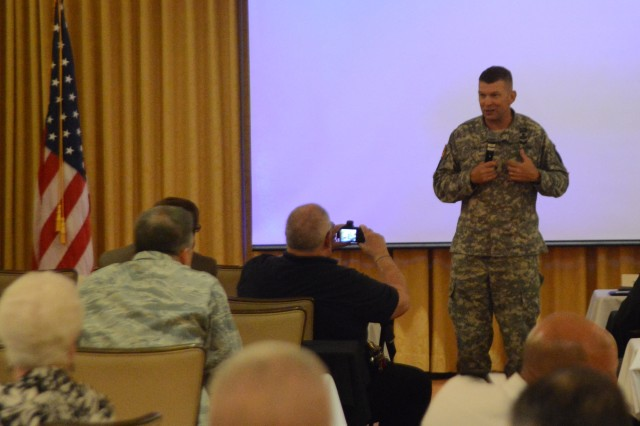 Maj. Gen. Jeffrey S. Buchanan, JFHQ-NCR/MDW commanding general,  addresses the audience during the 8th annual JFHQ-NCR/MDW Interagency Chaplains Conference held in Spates Community Club and Conference Center at Joint Base Myer-Henderson Hall, Va. on June 11, 2014.