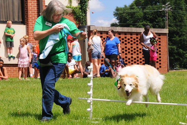 The Lucky Dog Sporting Group performed June 9 at the Center Library as part of the Paws to Read kickoff event.