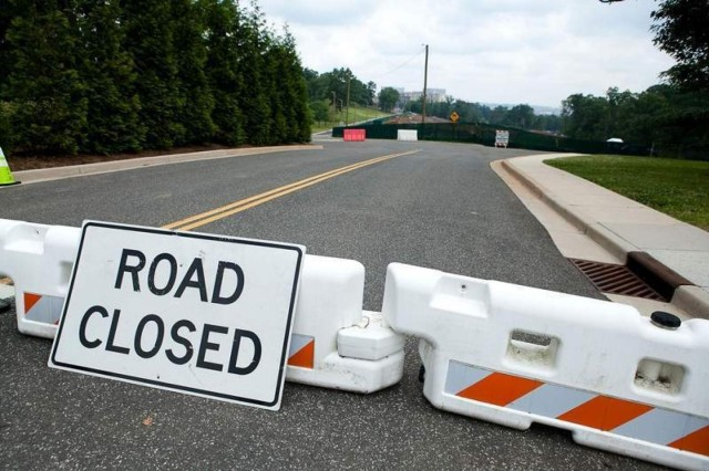 A sign at the intersection of Lee Avenue and McNair Road, near the Old Post Chapel, blocks traffic from proceeding further on McNair Road June 8. McNair Road, between Lee Avenue and Marshall Drive on the Fort Myer portion of Joint Base Myer-Henderson Hall, is closed to all traffic, including pedestrian and bicycle traffic, due to road damage.