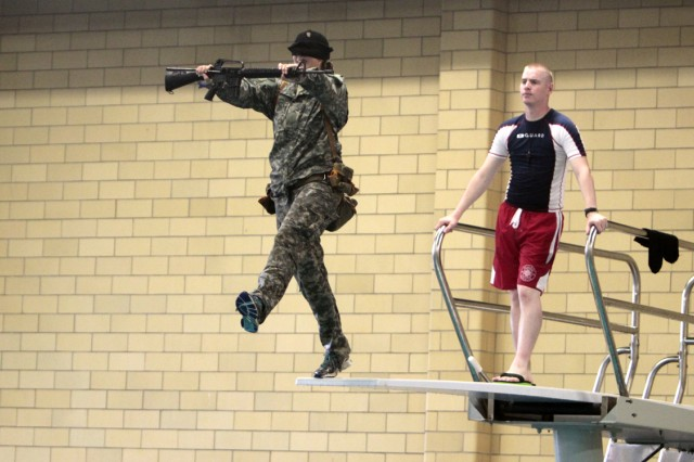 Cadets test their personal courage during the blindfolded high dive, June 11.