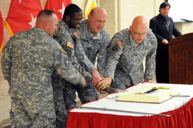 Maj. Gen. John Wharton, commanding general of U.S. Army Sustainment Command and Rock Island Arsenal, and Command Sgt. Maj. James Spencer, ASC senior enlisted adviser cut the Army birthday cake with the ASC's oldest Soldier, Chaplain (Lt. Col) Robert Land, ASC command chaplain, and youngest Soldier, Spec. Brandon Wilson, Headquarters and Headquarters Company, ASC, during the RIA Army birthday celebration at Heritage Hall, June 13. (Photo by Sgt. 1st Class Shannon Wright, ASC Public Affairs Office)