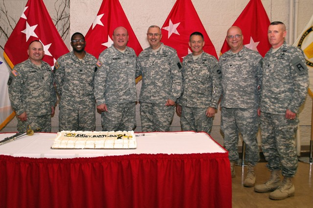 (From left to right) Command Sgt. Maj. James Spencer, Army Sustainment Command senior enlisted adviser; Spec. Brandon Wilson, Headquarters and Headquarters Company, ASC; Maj. Gen. John Wharton, commanding general of ASC and Rock Island Arsenal; Lt. Gen. Michael Tucker, commanding general of First U.S. Army; Gen. Daniel Allyn, commanding general of U.S. Forces Command; Chaplain (Lt. Col.) Robert Land, ASC command chaplain; and Command Sgt. Maj. Sam Young, First U.S. Army senior enlisted adviser,  gather for a picture to celebrate the Army's 239th birthday in Heritage Hall at Rock Island Arsenal, Ill., June 13. (Photo by Dawn Marie Barnett, ASC Public Affairs Office)