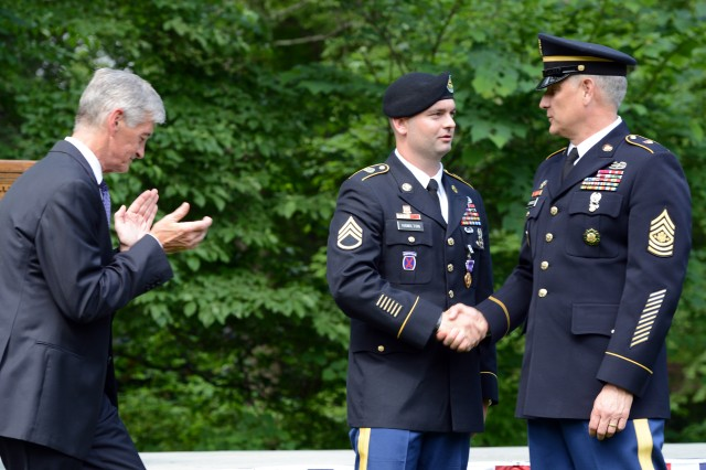 Sgt. Maj. of the Army Raymond F. Chandler III greets Staff Sgt. Joseph Hamilton after he received the Purple Heart from Secretary of the Army John McHugh, at President George Washington's Mount Vernon estate, Alexandria, Va., June 13, 2014.