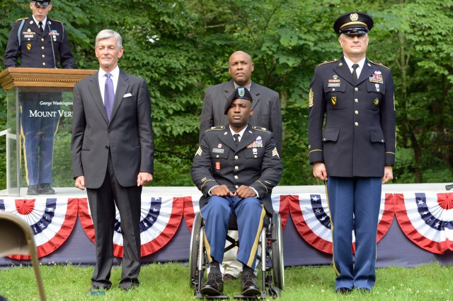 Sgt. Peter Francis (center) prepares to receive a Purple Heart from Secretary of the Army John McHugh, at President George Washington's Mount Vernon estate, Alexandria, Va., June 13, 2014.