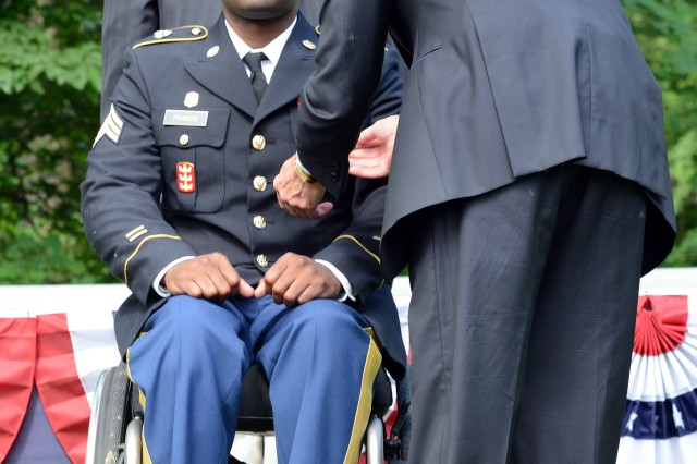 Sgt. Peter Francis, who was shot and paralyzed in Afghanistan in 2013, receives a Purple Heart from Secretary of the Army John McHugh, at President George Washington's Mount Vernon estate, Alexandria, Va., June 13, 2014.