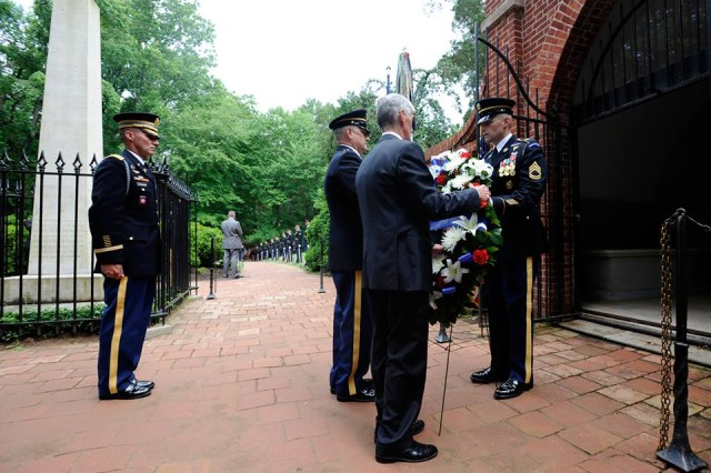 Secretary of the Army John McHugh and Sgt. Maj. of the Army Raymond F. Chandler III lay a wreath at the tomb of the Army's first commander-in-chief, George Washington, at Washington's Mount Vernon estate, Alexandria, Va., June 13, 2014.