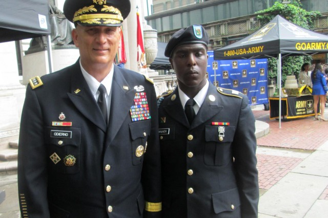 Army chief of staff Gen. Raymond Odierno with New York Army National Guard Soldier Pvt. Naiquan Walker, the youngest Soldier present at the Army Birthday display held in Bryant Park, New York City, June 13, 2014. The 1st Battalion, 69th Infantry, displayed weapons and vehicles as part of an event marking the Army's 239th Birthday, held the day before the Army Birthday, which is June 14.
