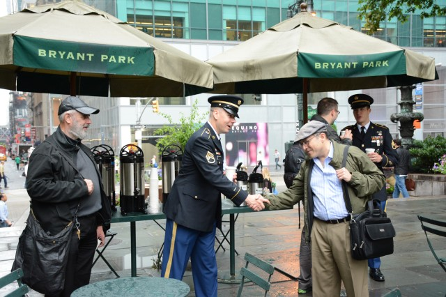 "Soldiers of the New York Recruiting Battalion talk with passersby during a pre-ceremony event, ""Coffee with Joe,"" June 13, 2014, in Bryant Park, Manhattan, N.Y."