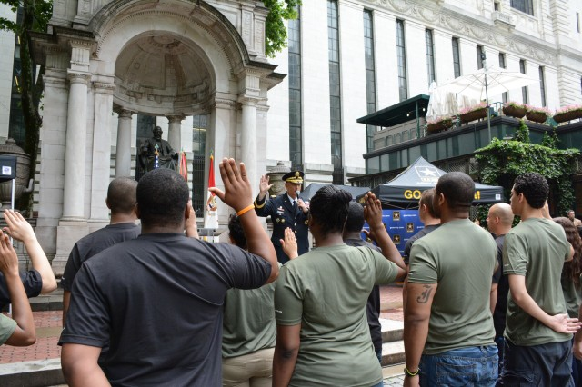 Being sworn in by the Chief of Staff of the Army Gen. Raymond T. Odierno, approximately 20 future Soldiers repeat their Oath of Enlistment at a public swearing in ceremony during the events commemorating the Army's 239th birthday, June 13, 2014, in Bryant Park, Manhattan, N.Y.