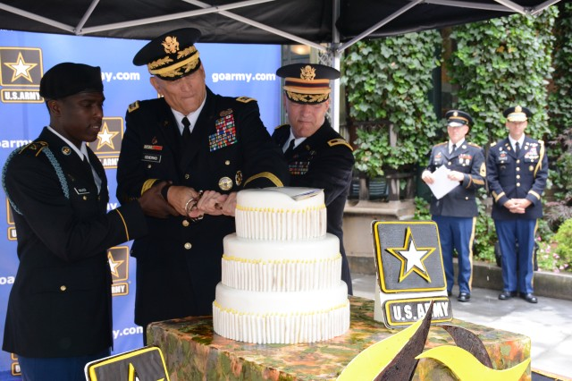 Chief of Staff of the Army Gen. Raymond T. Odierno (middle) cuts into the Army's 239th birthday cake with Col. Thomas Palmatier, a 37-year veteran and native of Ballston Spa, N.Y. (right), and Pvt. Naiquan Walker, 69th Infantry Regiment, New York Army National Guard (left) on June 13, 2014, in Bryant Park, Manhattan, N.Y. Traditionally, senior leaders cut into the cake with one the Army's longest-serving Soldiers and one of its newest Soldiers by their side.