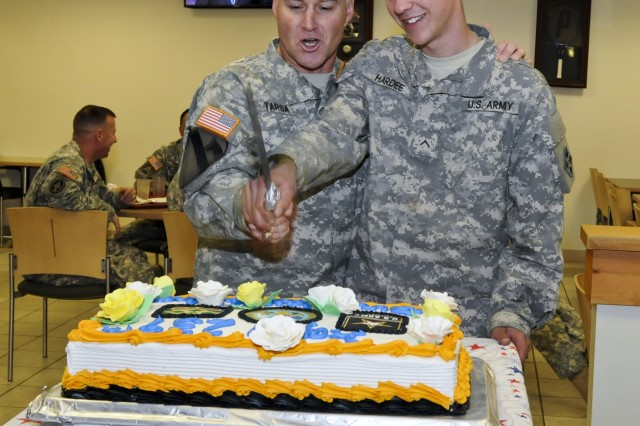 FORT CARSON, Colo. -- Acting Senior Commander Col. Mike Tarsa, 4th Infantry Division and Fort Carson, and Pvt. Cody Hardee, AH-64 Apache mechanic, Company D, 4th Attack Reconnaissance Battalion, 4th Aviation Regiment, 4th Combat Aviation Brigade, 4th Inf. Div., cut a cake in celebration of the Army's 239th birthday at Wolf dining facility June 12. (Photo by Sgt. William Smith, 4th Inf. Div. PAO)