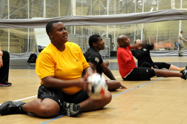 Retired Sgt. Monica Southall, Suffolk, Va., gets ready to serve during sitting volleyball practice for the 2014 U.S. Army Warrior Trials, West Point, N.Y. The Army Trials, June 15-19, highlight more than 100 Army, Marine and Air Force athletes competing in archery, cycling, shooting, sitting volleyball, swimming, track and field, and wheelchair basketball. The 2014 Army Warrior Trials, hosted by the U.S. Army Warrior Transition Command, help determine which Army athletes will compete on Team Army during the 2014 Warrior Games slated for Sep. 28-Oct. 4, Colorado Springs, Colo. (U.S. Army photo by Suzanne Ovel, Madigan Army Medical Center Public Affairs)