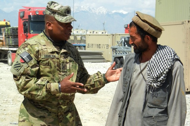 Staff Sgt. Terriance Hamilton, petroleum specialist with the 3d Sustainment Command (Expeditionary), discusses supply concerns with an Afghan June 5 at Bagram Air Base, Afghanistan. Hamilton is responsible for ensuring contractors who enter his Area of Operation receive important equipment they need.