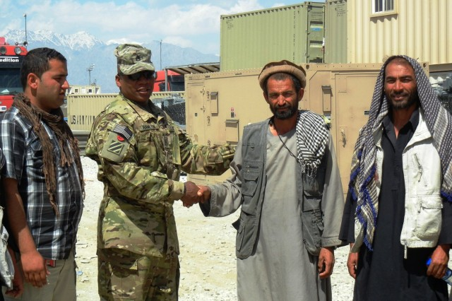 Staff Sgt. Terriance Hamilton, petroleum specialist with the 3d Sustainment Command (Expeditionary), discusses supply concerns with Afghans June 5 at Bagram Air Base, Afghanistan. Hamilton is responsible for ensuring contractors who enter his Area of Operation receive important equipment they need.
