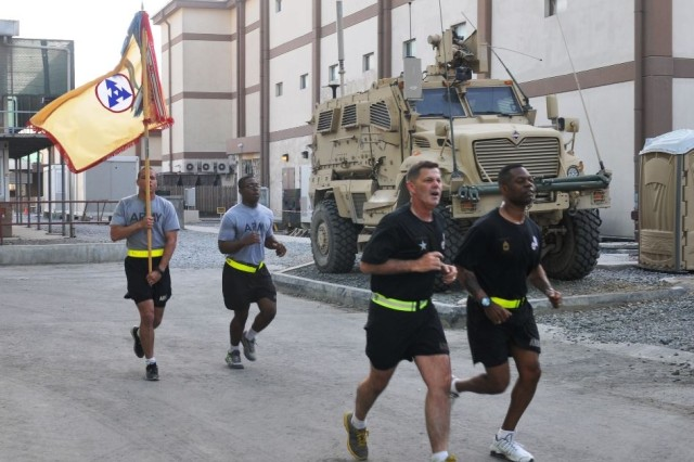 Brig. Gen. Donnie Walker Jr., commanding general of the 3d ESC and Command Sgt. Maj. Edward A. Bell, command sergeant major of the 3d ESC, led the 3d Sustainment Command (Expeditionary) on a 5K run and performed a cake cutting ceremony to celebrate the Army's birthday June 14 on New Kabul Compound, Afghanistan. (Photos by Army Maj. Jared Auchey)