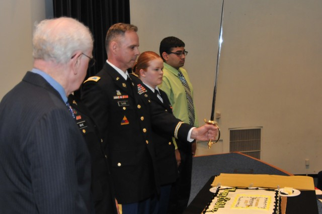 Col. Collier Slade prepares to cut the cake during the 239th Army birthday celebration June 13 at Natick Soldier Systems Center.