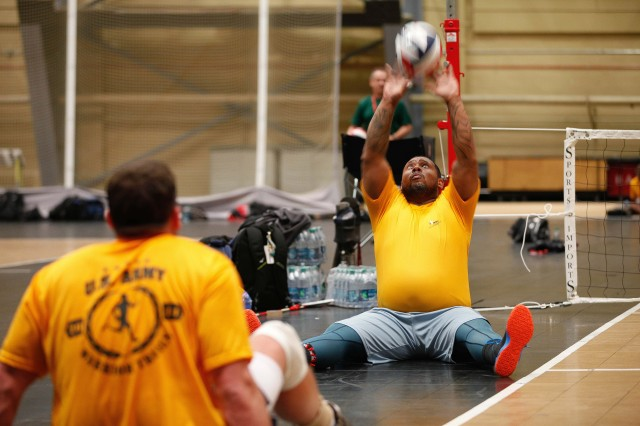 Staff Sgt. Isaac Rios practices sitting volleyball during the 2014 U.S. Army Warrior Trials at the U.S. Military Academy, West Point, New York, June 9, 2014.  Rios is assigned to the Joint Base Lewis-McChord Warrior Transition Battalion and is from Coney Island, New York.  The Army Warrior Transition Command is hosting the 2014 U.S. Army Warrior Trials June 15-19 at the U.S. Army Military Academy, West Point, New York.   More than 100 wounded, ill and injured Soldiers, Marines, Airmen and Veterans from across the country will face off in archery, shooting, cycling, track and field, swimming, sitting volleyball, and wheelchair basketball. The Army Warrior Trials will help determine the athletes who will represent Team Army in the 2014 Warrior Games slated for Sep. 28-Oct. 4, Colorado Springs, Colorado.