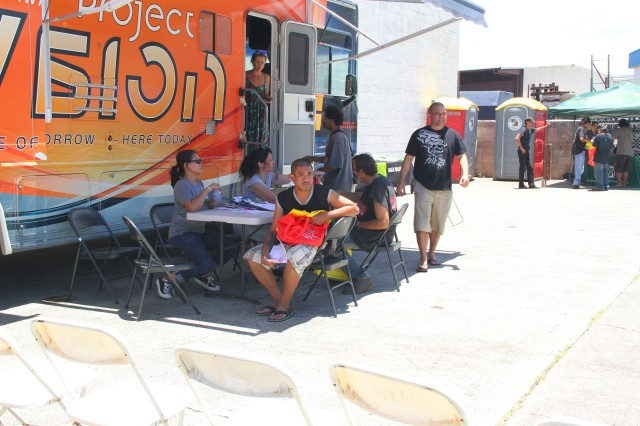 The Project Vision van rolled in to provide much needed eye exams and free prescription glasses during Tripler Army Medical Center's Aloha Service Fair, a human services outreach for Hawaii's homeless on Saturday, June 14, 2014 in Honolulu.
