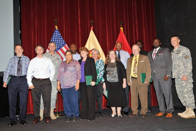 Commanding General, Lt. Gen. David Halverson and Command Sgt. Maj. Jeffrey Hartless, U.S. Army Installation Management Command, recognize civilian service during their first town hall meeting together.