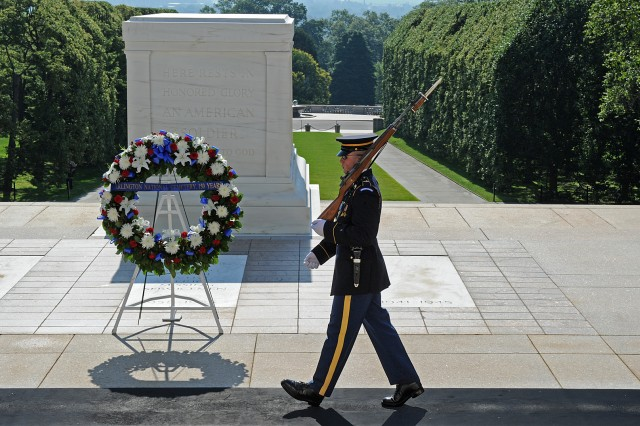 An Old Guard sentinel walks his post guarding the Tomb of the Unknowns at Arlington National Cemetery, Va. Arlington National Cemetery commemorated its 150th year by holding a variety of events for visitors, which culminated in a wreath-laying ceremony, June 16, 2014.
