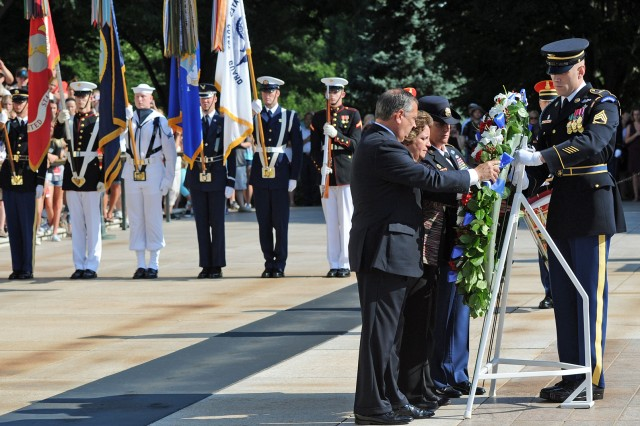 The Sergeant of the Guard assists in the placement of a wreath at the Tomb of the Unknowns at Arlington National Cemetery, Va., June 16, 2014, which commemorated the 150th anniversary of Arlington National Cemetery. From let to right: Arlington National Cemetery Superintendent Jack E. Lechner Jr.; Arlington National Cemetery Deputy Superintendent for Cemetery Administration Renea C. Yates; and Sgt. Maj. Brenda Curfam, senior enlisted advisor, Army National Military Cemeteries.