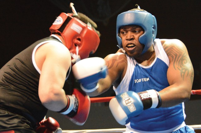 Wiesbaden's Dwan West glances a right hook off the chin of Adam Martinez in a heavyweight showdown.