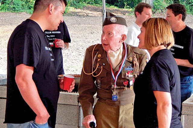 Volunteers talk to D-Day veterans during the special anniversary meal in Normandy, France.