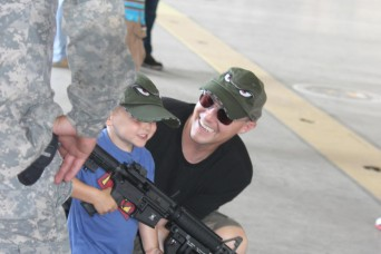 Soldiers and family members of 3rd Combat Aviation Brigade took their organizational day to the flight line of Hunter Army Airfield June 12 for a day of festivities designed for children and spouses to experience a day in the life of an Army Aviation...