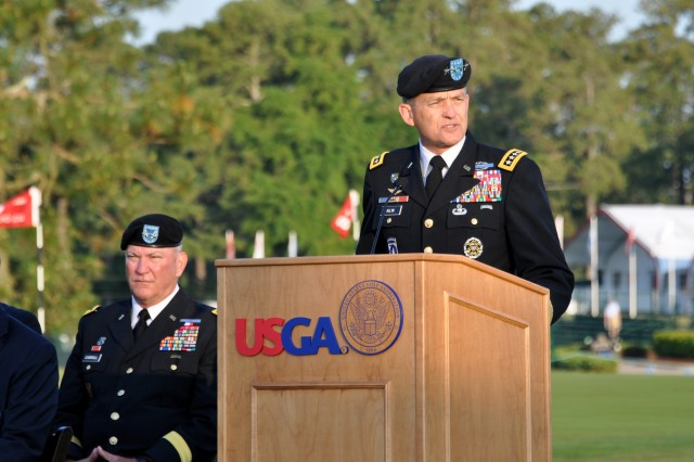 "PINEHURST, N.C. (June 14, 2014) - Gen. Daniel B. Allyn thanks the U.S. Golf Association and the Pinehurst Golf Resort for hosting 'Operation Open Glory' in honor of our nation's military men & women and in celebration of the U.S. Army's 239th birthday. ""And as we raise our Nation's colors this morning, we rededicate our role in preserving this Nation of 'liberty and justice for all."" Allyn is the FORSCOM commanding general. Maj. Gen. Leslie J. Carroll, FORSCOM chief of staff is seated to the left."