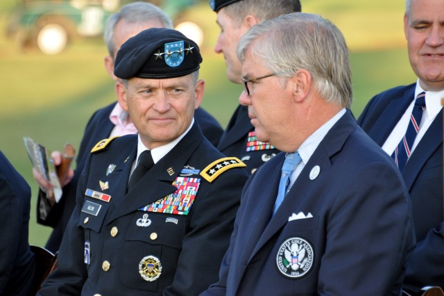 PINEHURST, N.C. (June 14, 2014) - Gen. Daniel B. Allyn talks with Mr. Thomas J. O'Toole before the start of the Operation Open Glory ceremony. Allyn is the FORSCOM commanding general. O'Toole is the U.S. Golf Association president. The USGA hosted the event to honor our nation's military and celebrate the 239th birthday of the U.S. Army.