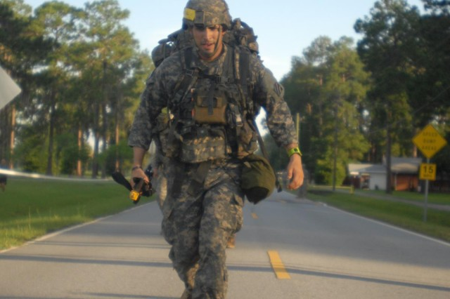 Sgt. Paul Rava, a combat medic with 3rd Battalion, 15th Infantry Regiment, 4th Infantry Brigade Combat Team, 3rd Infantry Division, and a native of Huntington Beach, Calif., takes his final steps of the 12-mile foot march during Expert Field Medical Badge testing on Fort Stewart, Ga., June 12, 2014. The foot march was the final event of the EFMB testing and had a time limit of three hours. (Photo by Sgt. Joshua Laidacker, 4th IBCT, 3rd ID, Public Affairs)