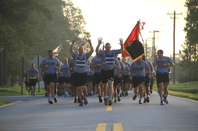 Command Sgt. Maj. Alan Hummel (left center) and Col. Thomas Gukeisen (center) lead the 4th Infantry Brigade Combat Team, known as the Vanguard Brigade, of 3rd Infantry Division, during the Army Birthday run June 13, 2014, on Fort Stewart, Ga. (Photo by Staff Sgt. Elvis Umanzor, 4th IBCT, 3rd ID, Public Affairs)