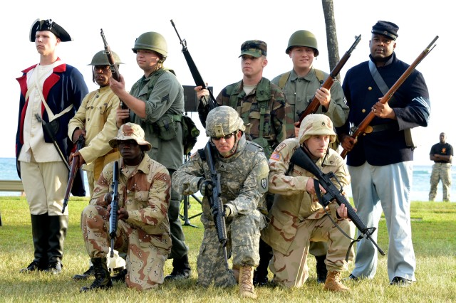 """HONOLULU- Soldiers from U.S. Army, Pacific Headquarters Support Company dressed in historically accurate uniforms from various periods of U.S. Army history during Pacific Theater Army Week. They joined in the """"Legacy of Honor"""" concert, a free two night sunset musical performance open to the public at Ft. DeRussey  as part of the celebration of the U.S. Army's 239th birthday."""